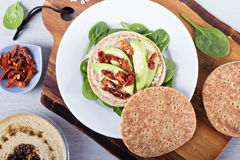 Vegan sandwich with hummus, avocado and tomatoes Stock Photography