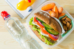 Vegan sandwich in lunch box with carrots and nuts Royalty Free Stock Photo