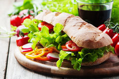 Vegan sandwich with salad, tomato and radish. Selective focus Royalty Free Stock Images