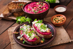 Vegan sandwiches with beetroot hummus, cucumber. And blue cheese stock images