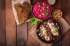 Vegan sandwiches with beetroot hummus, cucumber and blue cheese. Stock Photos