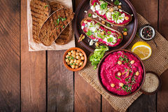 Vegan sandwiches with beetroot hummus, cucumber and blue cheese. Top view Stock Images