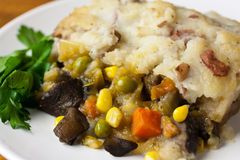 Vegan Shepherds Pie. With a sprig of fresh organic greens Stock Photography