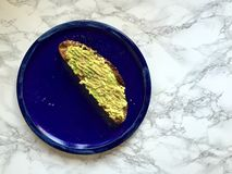 Vegan snack: Artisanal whole grain toast with avocado and sea salt Stock Photography