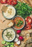 Vegan snack board. Flat-lay of Vegetarian dips hummus, babaganush, muhammara royalty free stock photos