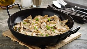 Soy meat stripes in creamy sauce. Vegan soy meat stripes and mushrooms in creamy sauce stock images