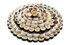 Vegan sushi on a big plate. Vegan raw-food sushi served on a big plate isolated on white background Royalty Free Stock Image