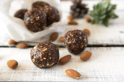 Vegan sweet delicious almond cocoa balls healthy and tasty food. On wooden table Stock Image