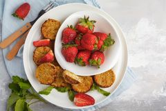 Vegan sweet tofu fritters with strawberries, vertical. Healthy v