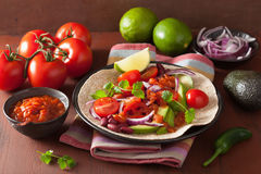 Vegan taco with avocado tomato kidney beans and salsa Stock Images
