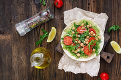 Vegan tacos with guacamole, chickpeas, tomatoes and arugula. Healthy food. Useful breakfast. Flat lay. Top view stock image