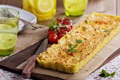 Vegan tart with millet crust and tofu filling stock images