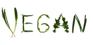 Vegan text. The word vegan spelled out with green vegetables royalty free stock image