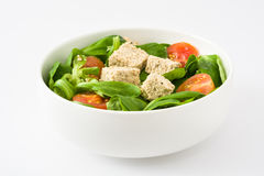 Vegan tofu salad with tomatoes and lamb's lettuce isolated on white background Stock Photos