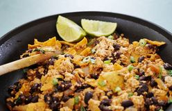 Vegan tofu scramble chilaquiles. With beans, scallions and lime Royalty Free Stock Image