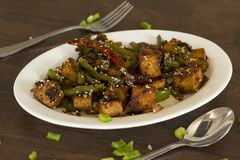 Vegan tofu stir fry. Is a healthy and delicious weeknight meal Stock Image