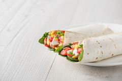 Vegan tofu wraps with pepper, corn, tomatoes and spinach Stock Images