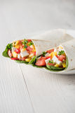 Vegan tofu wraps with pepper, corn, tomatoes and spinach Royalty Free Stock Photo