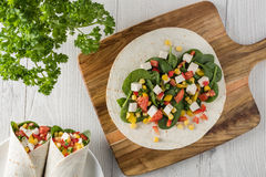 Vegan tofu wraps with pepper, corn, tomatoes and spinach Royalty Free Stock Photography