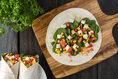 Vegan tofu wraps with pepper, corn, tomatoes and spinach Stock Image