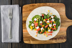 Vegan tofu wraps with pepper, corn, tomatoes and spinach Royalty Free Stock Photos