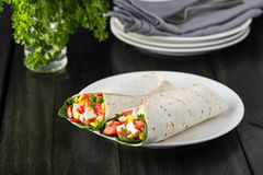 Vegan tofu wraps with pepper, corn, tomatoes and spinach. Vegan tofu wraps with pepper, corn, tomatoes royalty free stock photos