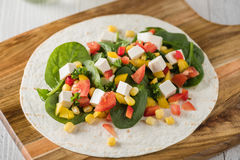 Vegan tofu wraps with pepper, corn, tomatoes and spinach Stock Photos
