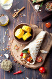 Vegan tortilla wrap, roll with grilled vegetabes, lentil, corn cob. Stock Photography