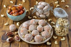Vegan truffles from dried fruits and cashews. On a brown background stock photo