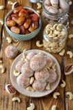 Vegan truffles from dried fruits and cashews. On a brown background royalty free stock image
