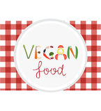 Vegan vegetables lettering on white plate. Vegetarian food. Vegan vegetables lettering on white plate. Vegetarian food Stock Photography