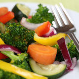 Vegan or vegetarian eating vegetables food on plate Stock Image
