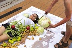 Vegan vegetarian humans cooking protest Stock Image