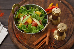 Vegan and vegetarian indian restaurant dish, fresh vegetable salad. Vegan and vegetarian dish, fresh vegetable salad in copper bowl. Indian restaurant, lettuce Royalty Free Stock Photography