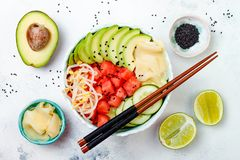 Hawaiian watermelon poke bowl with avocado, cucumber, mung bean sprouts and pickled ginger. Top view, overhead. Vegan watermelon poke bowl with avocado, cucumber Stock Photos