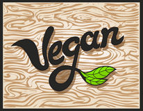 Vegan Word Inscription. Vector element for label, logo, badge, sticker, menu or icon. Calligraphic and typographic Illustration.  Stock Photography