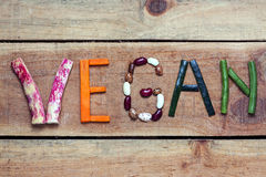 vegan word on wood background Royalty Free Stock Image