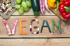 Vegan word on wood background Stock Photo