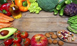 Vegan word on wood background and vegetable Stock Images