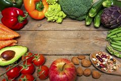 Vegan word on wood background and vegetable - food Stock Photography