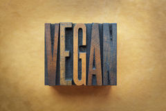 Vegan. The word VEGAN written in vintage letterpress type stock photography