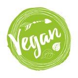 Vegano scritto a mano del segno dell'iscrizione per il ristorante, menu del caffè sul punto verde Immagini Stock
