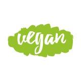 Vegano scritto a mano dell'etichetta dell'iscrizione per la stampa, autoadesivo, segno, etichetta sul punto verde Fotografia Stock Libera da Diritti