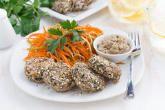 Vegans lunch - burgers bean and carrot salad on a plate. Closeup Stock Images