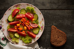 Vegans salad on the table top. Vegans salad on the wooden table top Royalty Free Stock Image