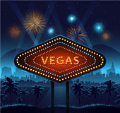 Vegas city sign at night and background lights fireworks Stock Photos