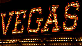 Vegas neon sign at night. Glittery neon sign with 'Vegas' outside a club Stock Images