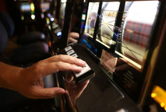 Vegas Slot Machine. A close-up of a slot machine being played in Las Vegas Stock Photo