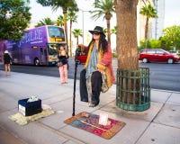 Vegas Street Performer. Las Vegas, Nevada - May 7, 2014: Street performer does levitation act on sidewalk along the Vegas strip Royalty Free Stock Images