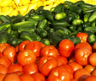 Vegatables or sale. Tomatoes, cucumbers ans squash or sale at a local farmers market Royalty Free Stock Image